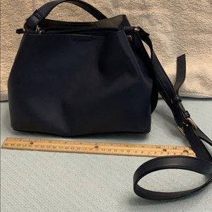 Navy Kate Spade crossbody purse.